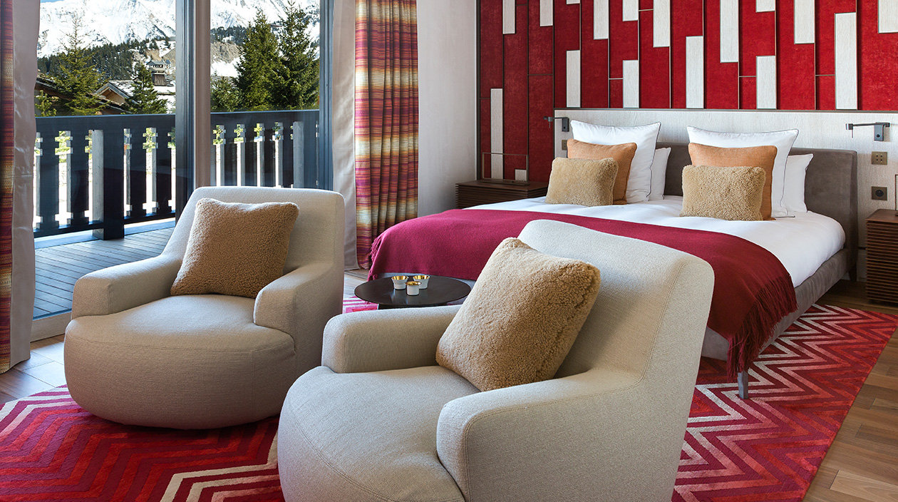 Sybille de Margerie - French interior designer - Chalet A, located in Courchevel 1850 - contemporary chalet - red ambiance bedroom - red carpets - red plaid - beige armchair - curtains zoffany - bed meridiani - Signatures Singulières magazine - The digital magazine of French talent