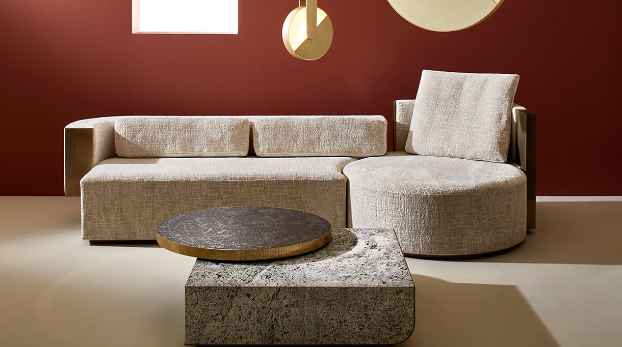 Rodolphe Parente - French interior designer - Gallery Pouenat - art metalworker in Paris - Threesome sofa - fabric and brass sofa - Sunset brass chandelier - Catwalk coffee table - brass coffee table - Travertine Tray - wall red - Signatures Singulières - The digital magazine of French talent