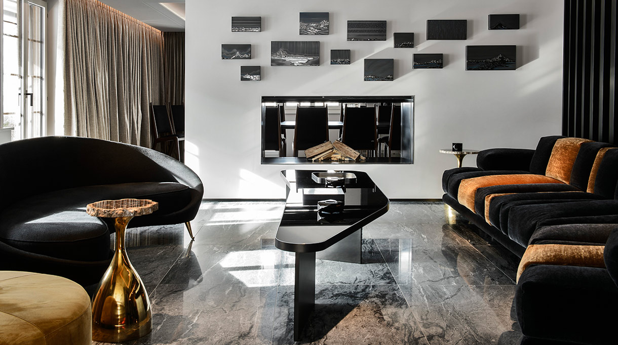 Thierry Lemaire - French interior designer - Black sofa - Marble floor - Black lacquer coffee table - stainless steel fireplace - Signatures Singulières - Magazine of French know-how - French know-how