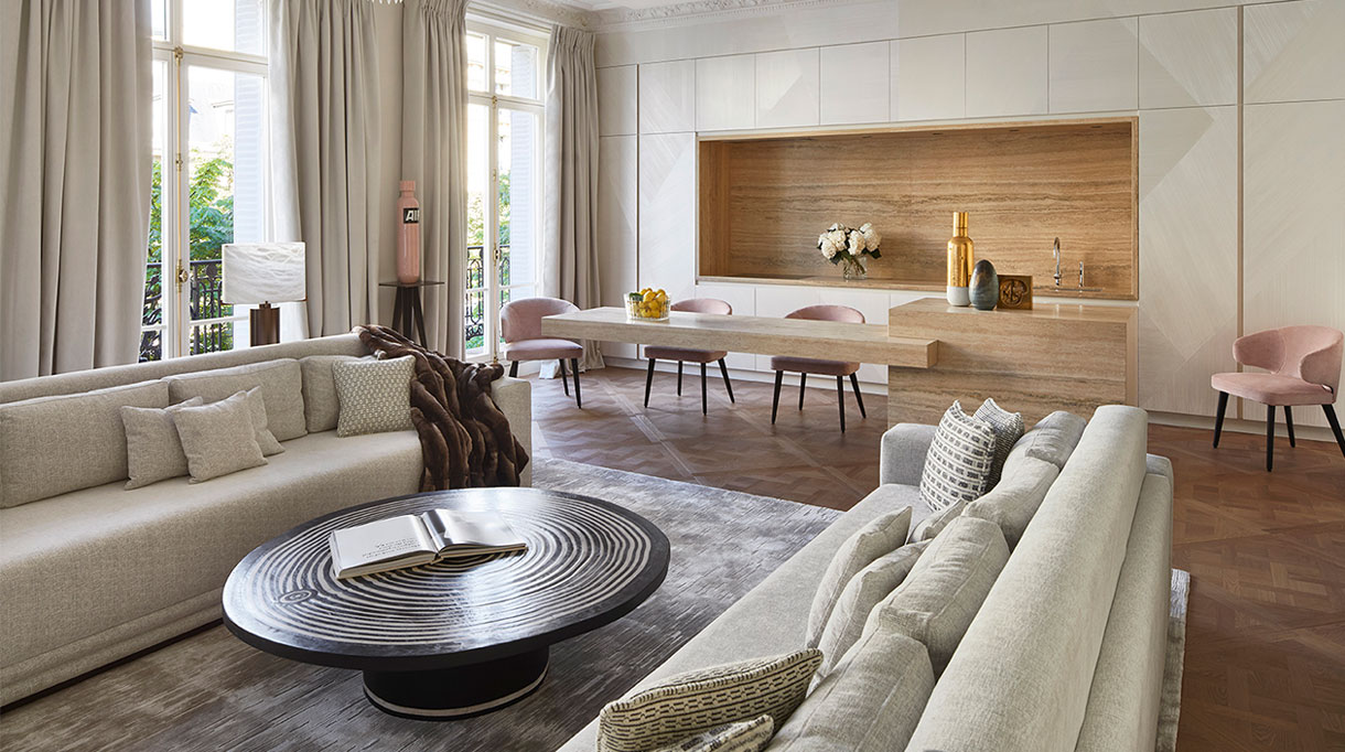 """stephanie coutas - french interior designer - luxury Parisian apartment - elitis fabric - Brass and alabaster table lamp - gallery glustin - ceramic sculpture """"Air"""" by Wouter Hoste - Gallery Patrick Fourtin - gallery fumi - G.P. & J. Baker fabric - Aston chairs Minotti - Ceramic sculpture by Wouter Hoste - travertine kitchen island - signatures singulieres - le magazine digital des talents francais"""