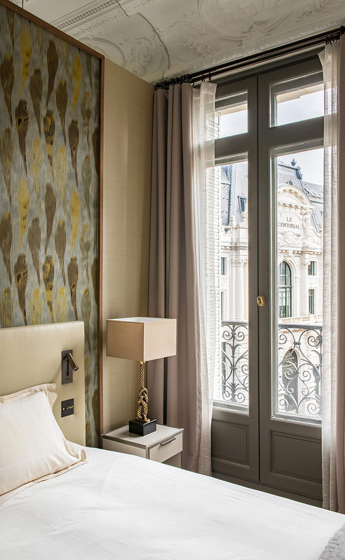 sebastien caron - french interior designer - parisian apartment with molding - Arte-International wallpaper - bedside table Ligne roset - Curtains fabrics Kvadrat and Kinnasand - beige leather headboard - signatures singulieres - le magazine digital des talents francais