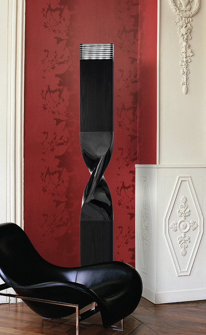 french lighting designer - black lamp - black leather armchair - red wall - signatures singulieres magazine